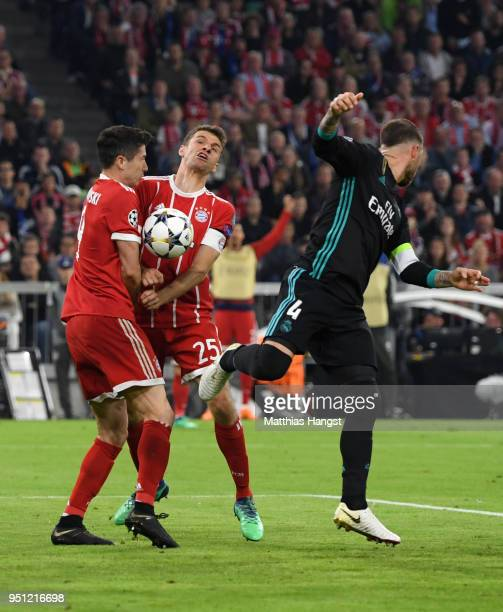 Robert Lewandowski of Bayern Muenchen and Thomas Mueller of Bayern Muenchen clash in the area during the UEFA Champions League Semi Final First Leg...