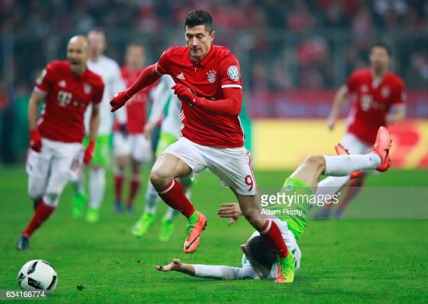 Robert Lewandowski of Bayern Muenchen breaks away from Ricardo Rodriguez of VfL Wolfsburg during the DFB Cup Round Of 16 match between Bayern...