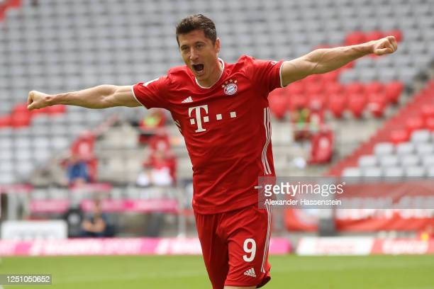 Robert Lewandowski of Bayern Muenchen celebrates after he head's his teams 2nd goal during the Bundesliga match between FC Bayern Muenchen and...
