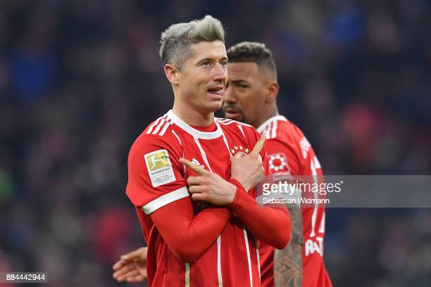 Robert Lewandowski of Bayern Muenchen celebrates after he scored a penalty goal to make it 31 during the Bundesliga match between FC Bayern Muenchen...