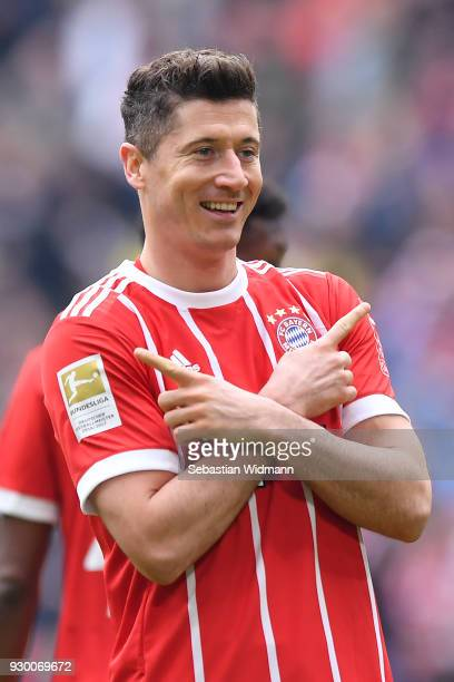 Robert Lewandowski of Bayern Muenchen celebrates after he scored a goal to make it 20 during the Bundesliga match between FC Bayern Muenchen and...