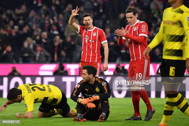 Robert Lewandowski of Bayern Muenchen celebrates after he scored a goal to make it 60 during the Bundesliga match between FC Bayern Muenchen and...