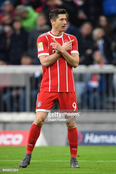 Robert Lewandowski of Bayern Muenchen celebrates after he scored a goal to make it 10 during the Bundesliga match between FC Bayern Muenchen and...