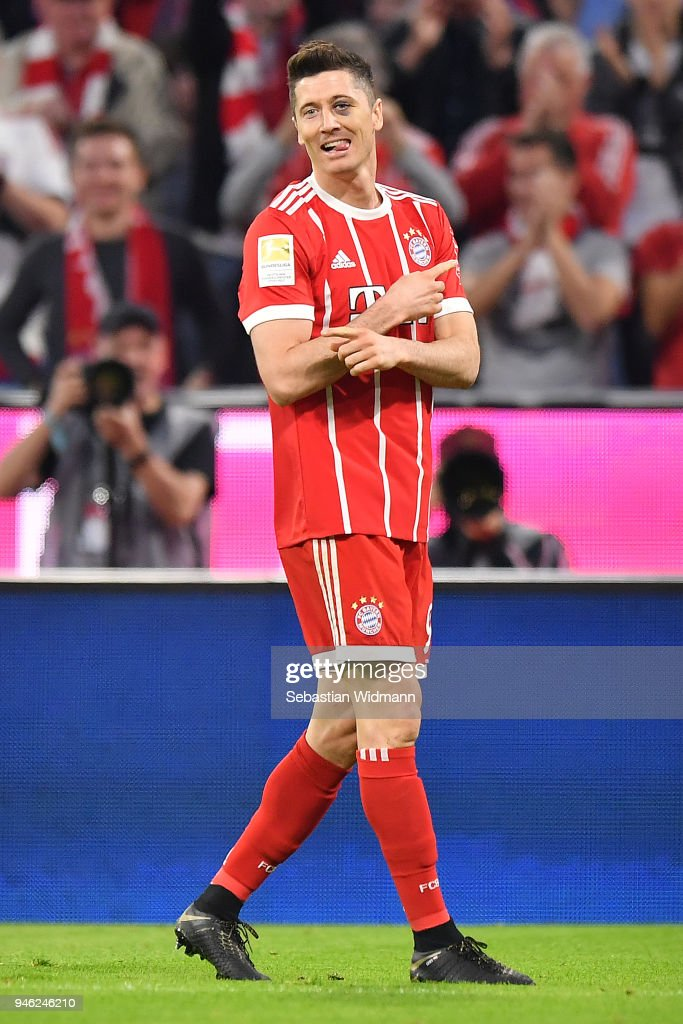 Robert Lewandowski of Bayern Muenchen celebrates after he scored a goal to make it 5:1 during the Bundesliga match between FC Bayern Muenchen and Borussia Moenchengladbach at Allianz Arena on April 14, 2018 in Munich, Germany.
