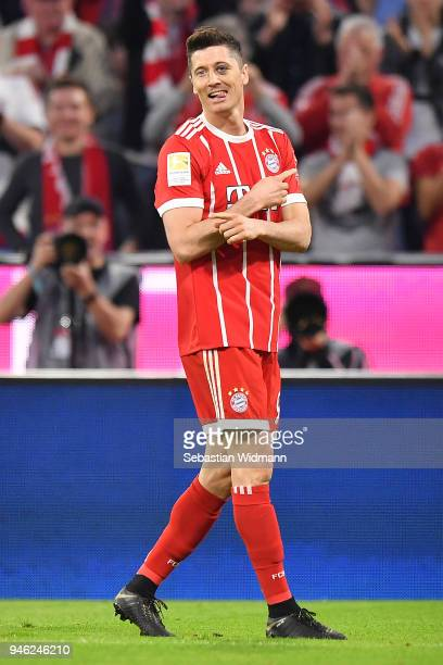 Robert Lewandowski of Bayern Muenchen celebrates after he scored a goal to make it 51 during the Bundesliga match between FC Bayern Muenchen and...