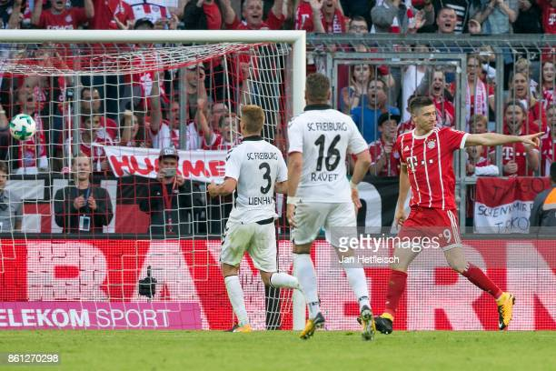 Robert Lewandowski of Bayern Muenchen celebrates after he scored his teams fourth goal to make it 40 during the Bundesliga match between FC Bayern...