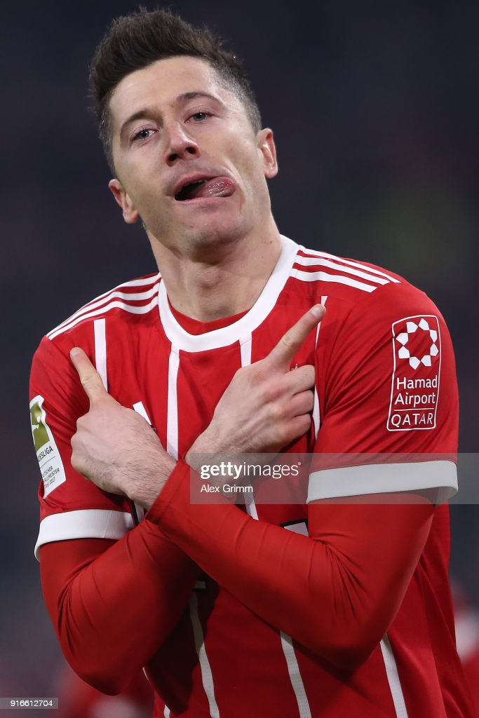 Robert Lewandowski of Bayern Muenchen celebrates after he scored to make it 1:0 during the Bundesliga match between FC Bayern Muenchen and FC Schalke 04 at Allianz Arena on February 10, 2018 in Munich, Germany.