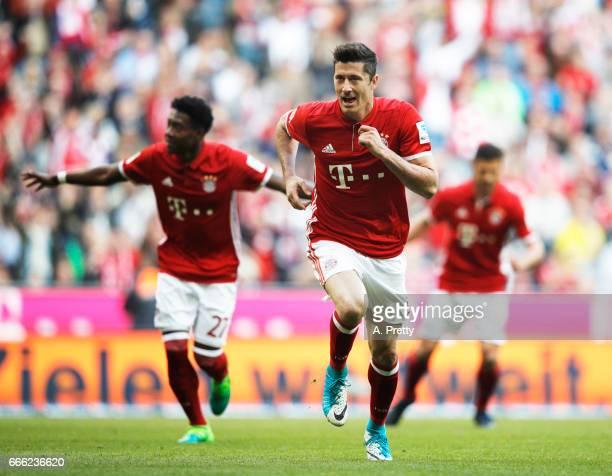 Robert Lewandowski of Bayern Muenchen celebrates after scoring a penalty goal during the Bundesliga match between Bayern Muenchen and Borussia...