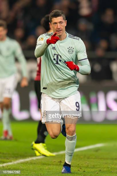 Robert Lewandowski of Bayern Muenchen celebrates after scoring his team's fifth goal during the Bundesliga match between Hannover 96 and FC Bayern...