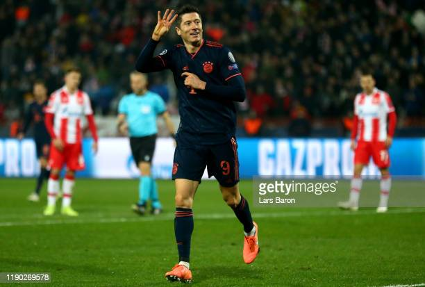 Robert Lewandowski of Bayern Muenchen celebrates after scoring his fourth and his teams fives goal during the UEFA Champions League group B match...
