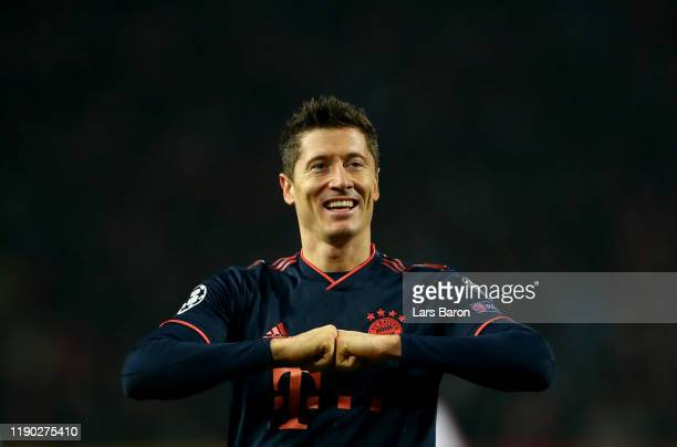 Robert Lewandowski of Bayern Muenchen celebrates after scoring his third and his teams fourth goal during the UEFA Champions League group B match...
