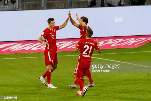 Robert Lewandowski of Bayern Muenchen celebrates after scoring his team's third goal with teammates during the Bundesliga match between FC Bayern...