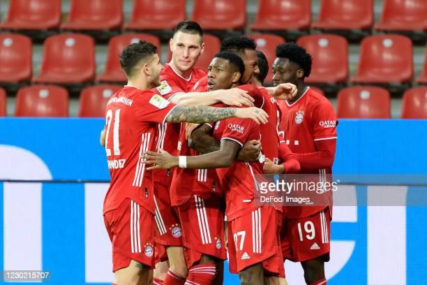 Robert Lewandowski of Bayern Muenchen celebrates after scoring his team's second goal with teammates during the Bundesliga match between Bayer 04...