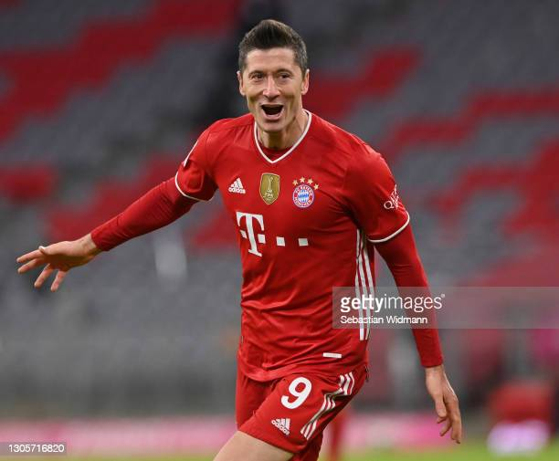 Robert Lewandowski of Bayern Muenchen celebrates after scoring his team's fourth goal during the Bundesliga match between FC Bayern Muenchen and...