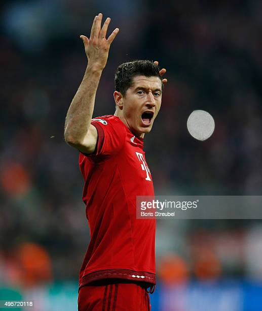 Robert Lewandowski of Bayern Muenchen celebrates after scoring his team's first goal during the UEFA Champions League Group F match between FC Bayern...