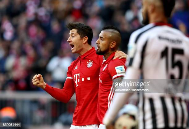 Robert Lewandowski of Bayern Muenchen celebrates after scoring his teams first goal during the Bundesliga match between Bayern Muenchen and Eintracht...