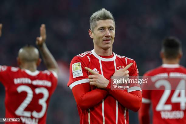 Robert Lewandowski of Bayern Muenchen celebrates after scoring his team`s third goal during the Bundesliga match between FC Bayern Muenchen and...