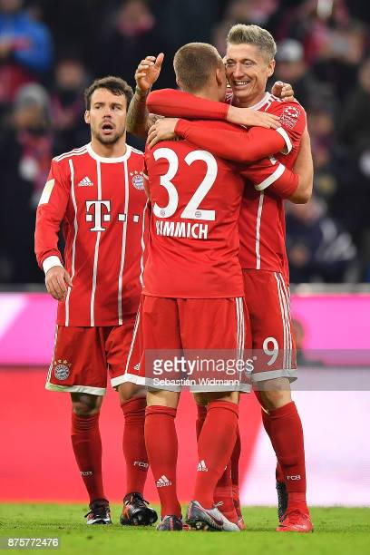 Robert Lewandowski of Bayern Muenchen celebrates after the scored his teams third goal to make it 30 with Joshua Kimmich of Bayern Muenchen during...