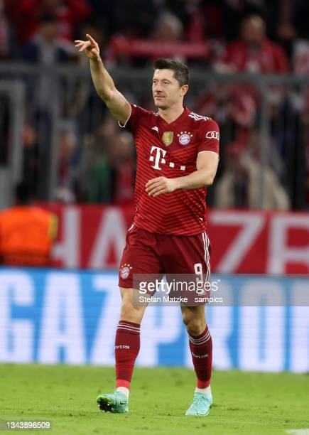 Robert Lewandowski of Bayern Muenchen celebrates as he scores the goal to 2:0 during the UEFA Champions League group E match between FC Bayern...