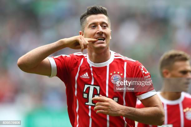 Robert Lewandowski of Bayern Muenchen celebrates having scored his teams second goal to make it 20 during the Bundesliga match between SV Werder...