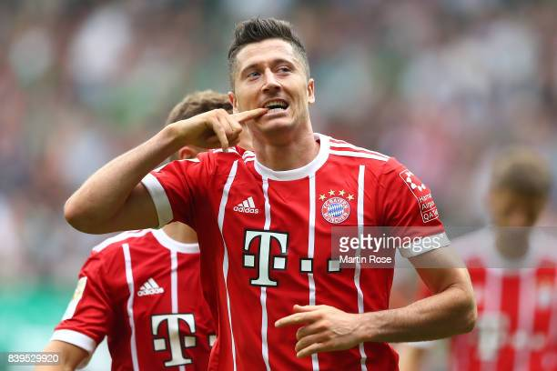 Robert Lewandowski of Bayern Muenchen celebrates having scored his teams second goal to make it 20 during the Bundesliga match between SV Werder...