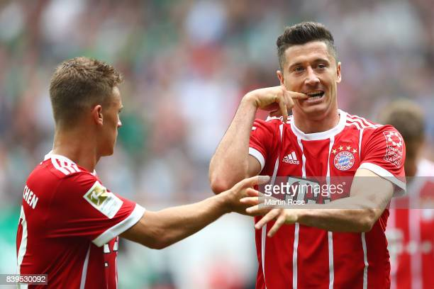 Robert Lewandowski of Bayern Muenchen celebrates having scored his teams second goal to make it 20 with Joshua Kimmich of Bayern Muenchen during the...