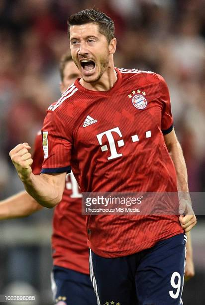 Robert Lewandowski of Bayern Muenchen celebrates scoring a goal after taking penalty for the second time during the Bundesliga match between FC...