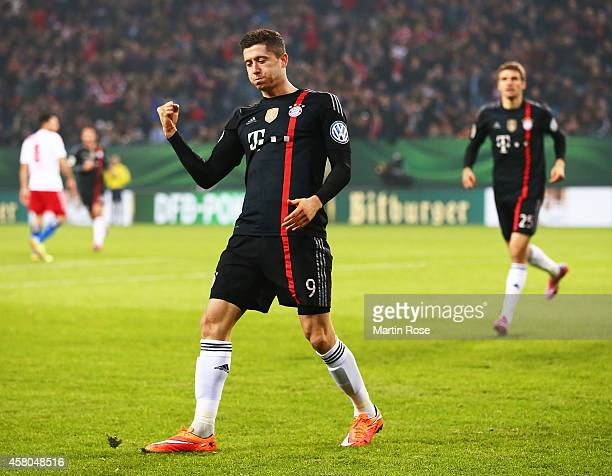 Robert Lewandowski of Bayern Muenchen celebrates scoring a goal during the DFB Cup match between Hamburger SV and FC Bayern Muenchen at Imtech Arena...