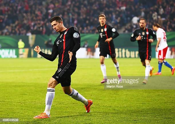 Robert Lewandowski of Bayern Muenchen celebrates scoring a goal during the DFB Cup match between Hamburger SV and FC Bayern Muenchen at Imtech Arena...