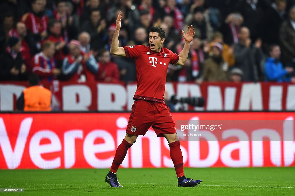 Robert Lewandowski of Bayern Muenchen celebrates scoring his side's first goal during the UEFA Champions League Group F match between FC Bayern Muenchen and Arsenal FC at the Allianz Arena on November 4, 2015 in Munich, Germany.