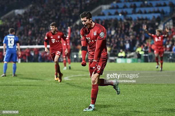 Robert Lewandowski of Bayern Muenchen celebrates scoring his side's first goal during the DFB Cup quarter final match between VfL Bochum and Bayern...