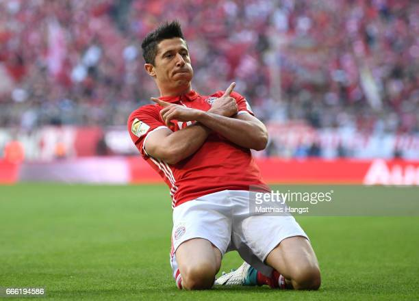 Robert Lewandowski of Bayern Muenchen celebrates scoring his sides second goal during the Bundesliga match between Bayern Muenchen and Borussia...