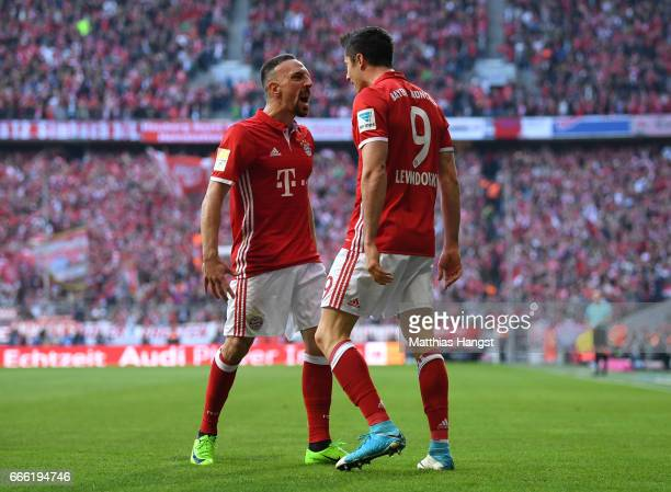 Robert Lewandowski of Bayern Muenchen celebrates scoring his sides second goal with Franck Ribery of Bayern Muenchen during the Bundesliga match...