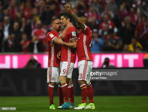Robert Lewandowski of Bayern Muenchen celebrates scoring his sides fourth goal with his Bayern Muenchen team mates during the Bundesliga match...