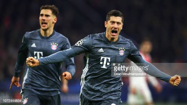 Robert Lewandowski of Bayern Muenchen celebrates scoring his teams second goal of the game during the UEFA Champions League Group E match between...