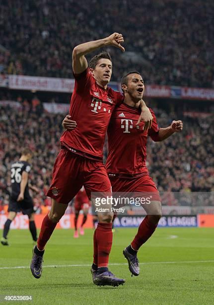 Robert Lewandowski of Bayern Muenchen celebrates scoring his teams second goal with Thiago Alcantara of Bayern Muenchen during the UEFA Champions...