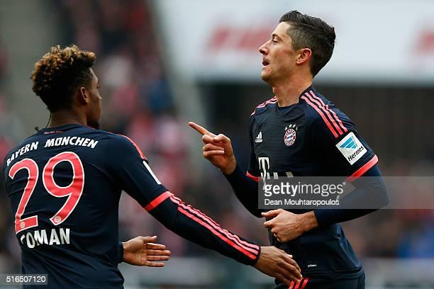 Robert Lewandowski of Bayern Muenchen celebrates scoring his teams first goal of the game during the Bundesliga match between 1 FC Koeln and FC...