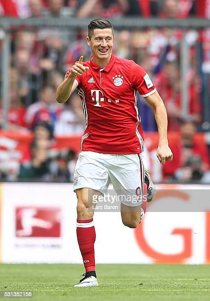 Robert Lewandowski of Bayern Muenchen celebrates scoring his team's first goal during the Bundesliga match between FC Bayern Muenchen and Hannover 96...
