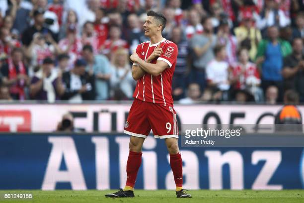 Robert Lewandowski of Bayern Muenchen celebrates scoring his teams fourth goal to make it 40 during the Bundesliga match between FC Bayern Muenchen...