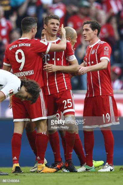 Robert Lewandowski of Bayern Muenchen celebrates scoring his teams fourth goal to make it 40 with Thomas Mueller of Bayern Muenchen and Sebastian...