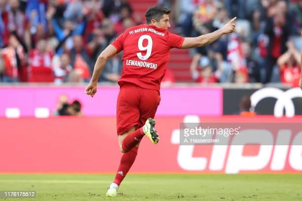 Robert Lewandowski of Bayern Muenchen celebrates scoring teh 2nd team goal during the Bundesliga match between FC Bayern Muenchen and 1. FC Koeln at...