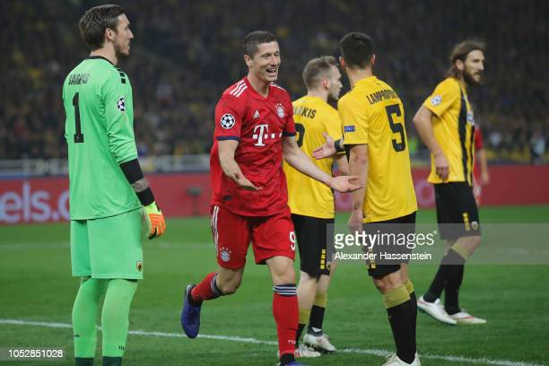 Robert Lewandowski of Bayern Muenchen celebrates scoring the 2nd team goal during the Group E match of the UEFA Champions League between AEK Athens...