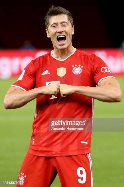 Robert Lewandowski of Bayern Muenchen celebrates scoring the 4th team goal during the DFB Cup final match between Bayer 04 Leverkusen and FC Bayern...