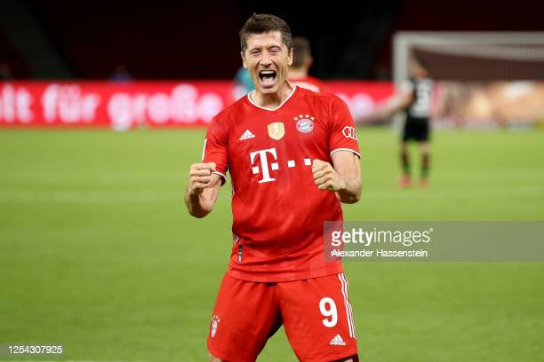 Robert Lewandowski of Bayern Muenchen celebrates scoring the 4th team goal during the DFB Cup final match between Bayer 04 Leverkusen and FC Bayern...
