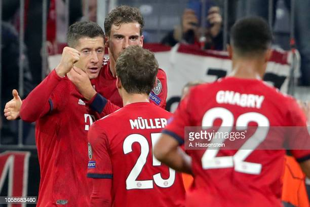 Robert Lewandowski of Bayern Muenchen celebrates scoring the opening goal with his team mates during the Group E match of the UEFA Champions League...