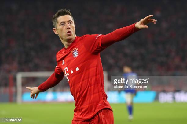 Robert Lewandowski of Bayern Muenchen celebrates scoring the opening goal during the Bundesliga match between FC Bayern Muenchen and FC Schalke 04 at...