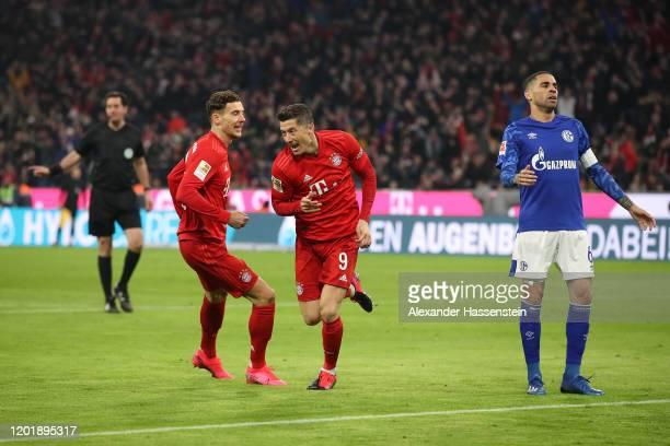 Robert Lewandowski of Bayern Muenchen celebrates scoring the opening goal with his team mate Leon Goretzka during the Bundesliga match between FC...