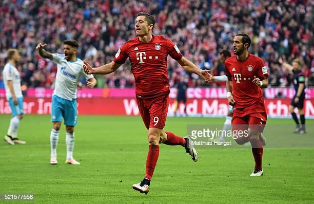 Robert Lewandowski of Bayern Muenchen celebrates scoring to scoring the opening goal during the Bundesliga match between FC Bayern Muenchen and FC...