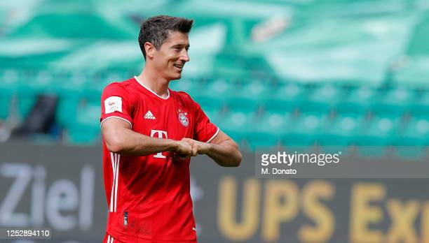 Robert Lewandowski of Bayern Muenchen celebrates the third goal for his team during the Bundesliga match between VfL Wolfsburg and FC Bayern Muenchen...