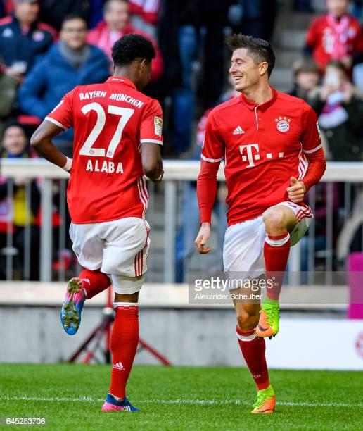 Robert Lewandowski of Bayern Muenchen celebrates the third goal for his team with David Alaba of Bayern Muenchen during the Bundesliga match between...